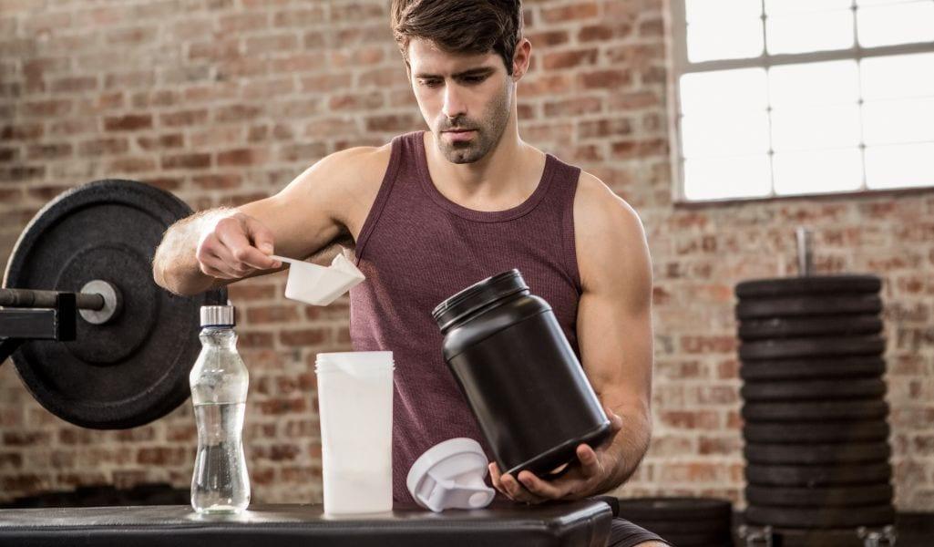 Man mixing supplement powder