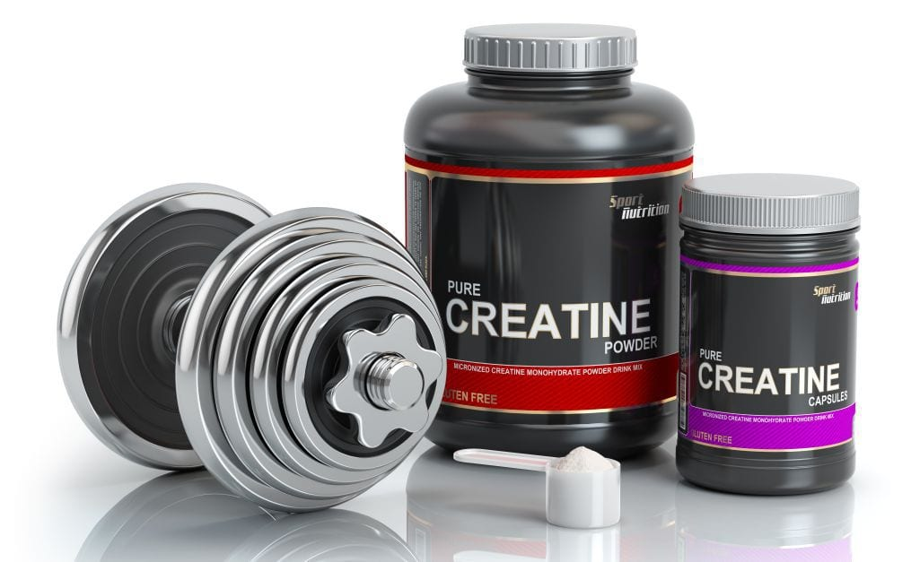 Creatine containers next to barbell